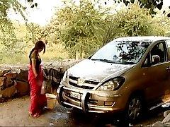 Indian bhabhi outdoor car wash   displaying deep cleavag