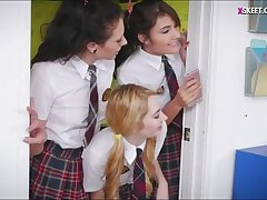 Three kinky teen schoolgirls make out