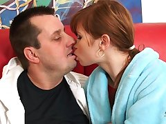 Redhead in red nylon overal fucked by older man on sofa