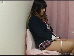 Japanese Schoolgirl Masturbating while reading a hentai manga